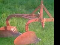 I have three 2 bottom breaking plows for sale all are