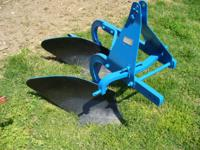 This is a FORD 2-16 plow, great shape, new paint