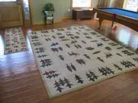 Matching set of area rugs with lodge/cabin theme. Rugs