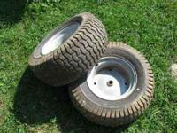 2 Nice lawn Carlisle tires, good shape. Phone No. 1
