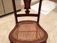 Chair with inlay on back and cane seat has been in my