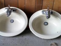2 cream oval shaped sinks with faucets for sale. In