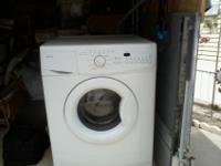 2 cu ft front loader washing machine, 1 year old paid