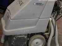 2 Advance Terra industrial Vacuums. Both machines have