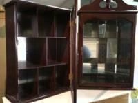 2 Mirror back dark wood display cabinets with glass