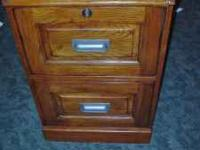 This mission style oak file cabinet comes with 2 keys