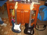 Two elc guitar,s 65.00 each, One small portable amp