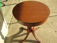 2 round antique looking round table $25 apiece firm