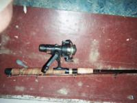 one open faced reel, zebco psg05 with pole, one closed