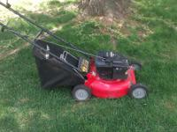 5.5 hp newer push mower that is every clean and light