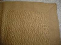 Two used jute area rugs for sale. Both have cloth