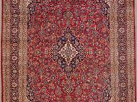 TWO ANTIQUE HIGH-QUALITY ORIENTAL RUGS. One is a 9 x 12