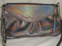 1st handbag is truly one of a kind. It is handmade,