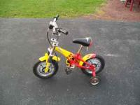 We have 2 Little kids bike with the training wheels on.