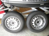 These are 2 Mastercraft Glacier-grip tires. Size 205/65