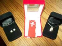 2 sterlin silver necklaces one with mother of pearl and