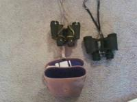 two nice older style pairs of binoculars, one set with