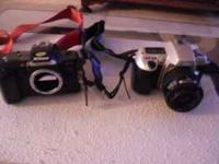 2 Nikon cameras $50.00 Call Kim  Location: MONROEVILLE