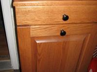 I HAVE 2 OAK TRASH BINS VERY HEAVY WITH DRAWER I BOUGHT