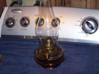 2 old oil lamps in good condition,1 has metal bottom