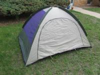 This is an older 2-person outdoor tents. The primary