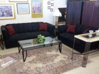 For sale we have a really good modern black sofa set.