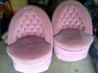 2 pink chairs on wheels no rips in material. been in