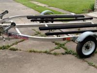 2 Place Karavan jet ski trailer. Has new swivel tongue