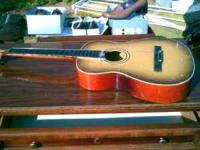 2 guitars that are in need of some tlc. The guitar that