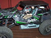 I have 2 rc trucks for sale: 1 -Axial Wraith badest of