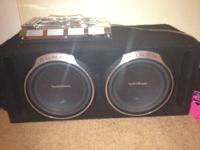 2 p3 12's in box with 1200 watt rms audiobahn amp.