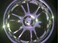 2 sets of 22 inch 5 lug rims w/ tires for sale. $700.00
