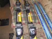 2 sets of skis and 2 pair of ski boots. One set was