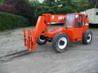 2 SKYTRAK MODEL 8042 ROUGH TERRAIN FORKLIFTS. THESE