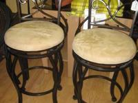 These stunning bar stools are slate and have a mosaic