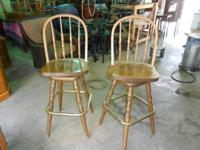 2 SWIVEL BAR STOOLS MAPLE COLOR 29 IN FROM FLOOR TO THE