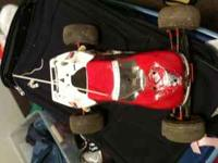 2 Team Losi Trucks Both with custom paint jobs, One is