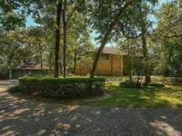 Privately nestled amidst the trees in a cul de sac on