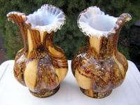 Gorgeous pair of Victorian time art glass vases. Design