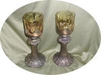 "I have for sale 2 vintage metal 10"" standing candle"