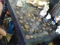 2 vintage end tables black in color they have rocks and