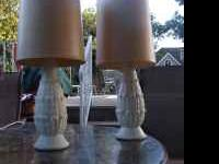 Very cute and very vintage table lamps. The bottom is
