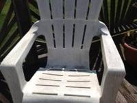 2 White Plastic Adirondack Chairs - one has crack in