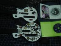 Including: 2 guitar hero controllers 1 Guitar Hero 3: