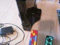 2 Nintendo Wii systems (1 black, 1 white), 4 WiiPlus