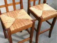 For sale is 2 very nice wood and wicker bar stools.