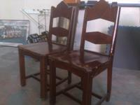 Two matching wooden chairs, perfect for small kitchen