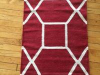 The dynamic octagon pattern of this artfully handwoven