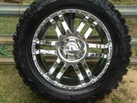 "Used 33"" cooper discovery LT mud terrains. 2 with at"