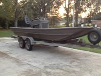 Aluminum 20 ft mud boat built 1990. Has a 2002 chev.